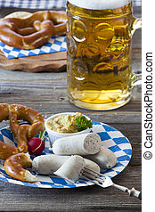 Veal sausage and pretzels - Oktoberfest meal with Veal...