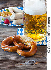 A large glass of beer and a pretzel - A cold beer in Seidel,...