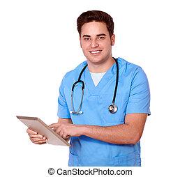 Caucasian male nurse using his tablet pc - Portrait of a...