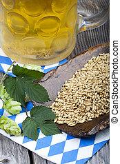 Beer, hops and grain, brewing ingredients - Glass of beer,...