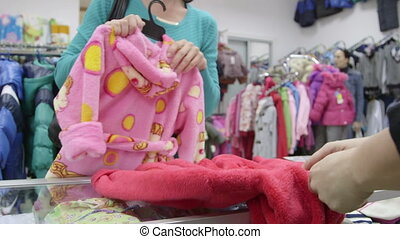 Checkout Of Clothing Store - Sales Assistant Helping...