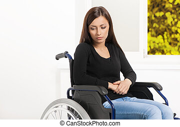 Women with disability. Depressed young women sitting at the...