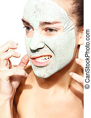 girl in the mask with green clay - impatient woman in the...