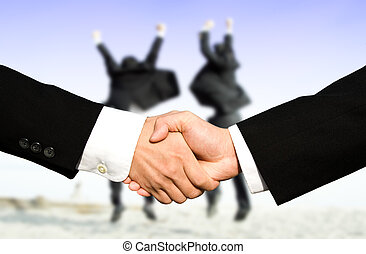 Success businessmen shaking hands - Two businessmen shaking...