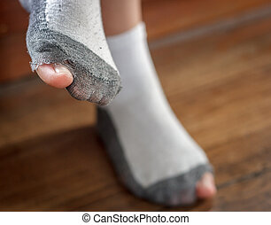 worn out socks with a hole and toes - worn out socks with a...