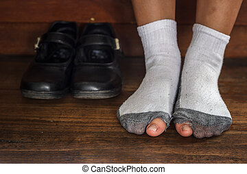 worn out dirty socks with a hole and toes. - worn out dirty...