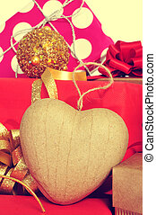 christmas gifts - closeup a heart-shaped ornament and some...