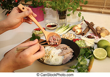 Preparing Pho, Vietnamese rice noodles with beef