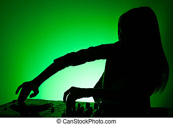 DJ silhouette. Female DJ silhouette isolated on green