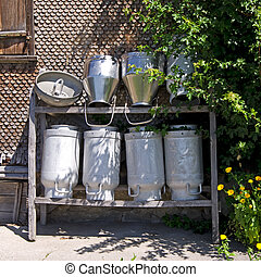 milk cans - many milk cans on old farm in bavaria, germany