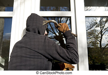 housebreaker - housebraker with tool trying to open window