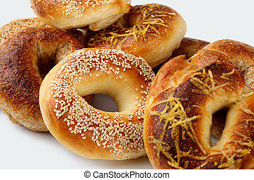Bagels - assorted, fresh, flavorful bagels on a white...