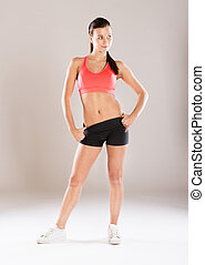 Fitness portrait - Young fitness model is posing in studio