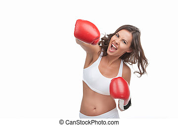 Woman boxing. Furious young women boxing while isolated on...