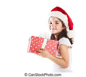 Small girl in santa hat with christmas gift - Happy small...
