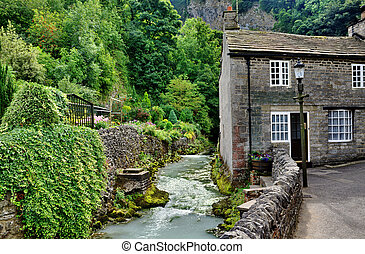 River and cottage in Castleton,Derbyshire - View of a stone...