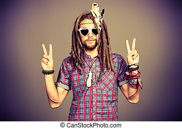 Jamaica lifestyle - Portrait of a hippie young man in...