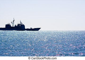 Naval Ship - A naval ship leaves the bay.