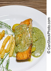 salmon steak with green sauce - top view roasted salmon...