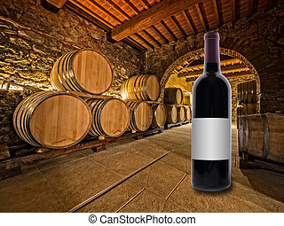 wine bottle and barrels - red wine bottle on the floor of a...