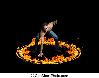 Blazing flames on black background - Man in a circle of fire...