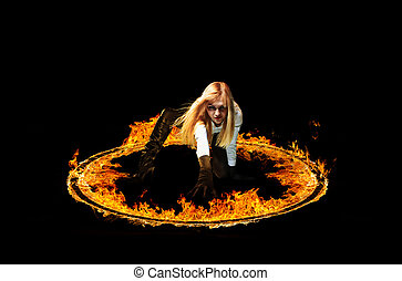 Blazing flames on black background - Woman in a circle of...