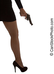 Legs of dangerous woman with handgun and black shoes...