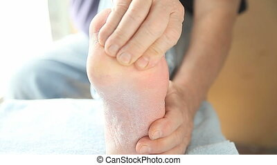 man massages ball of foot - a man has discomfort on the...