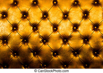 Luxury golden leather close-up background with great detail...
