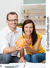 Young couple planning for the future - Enthusiastic...