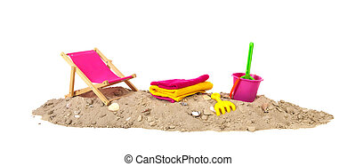 Beach sand with chair and toys