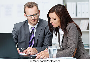 Business partners having a discussion - Succesful male and...