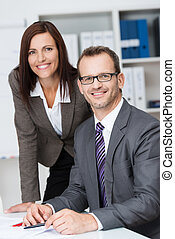 Smiling business manager with his secretary - Smiling...