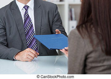Employment interview with a close up view of a female...