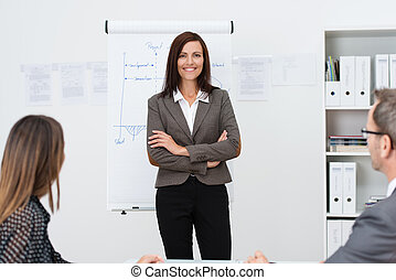 Confident businesswoman giving a presentation to her...
