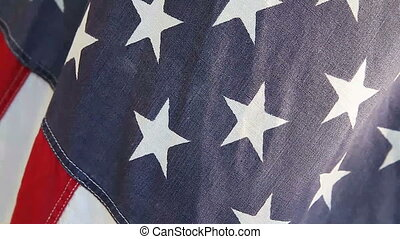 American flag fades to abstract - closeup of windblown USA...