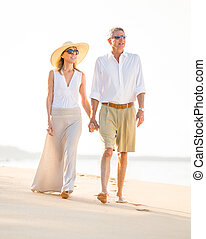 Happy senior couple on the beach Retirement Luxury Tropical...