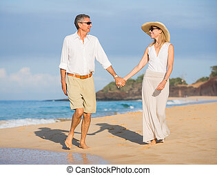 Happy senior couple on the beach. Retirement Luxury Tropical...