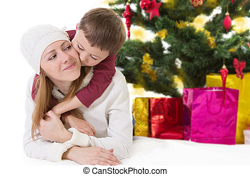 Happy mother with hugging boy
