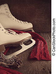 Skates for figure skating on a wooden background, toned