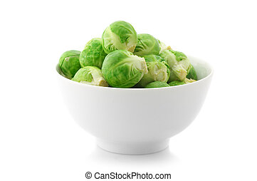 Brussel sprouts in bowl isolated on white background.
