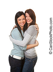 Two girlfriends in a tender embrace - Two young girls hug...