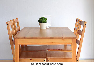 Wooden dining table for 4.