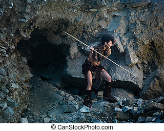 cavewoman hunting with spear - caucasian woman dressed as a...