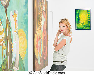 beautiful woman visiting an art gallery - close-up of...