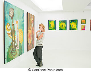 woman visiting art museum - young caucasian woman standing...