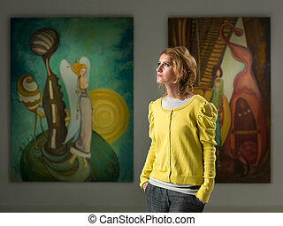 attractive young woman at art exhibition