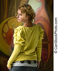 beautiful woman visiting art exhibition - rear view of woman...