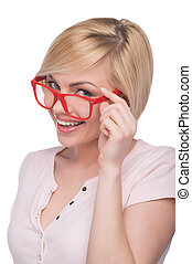 Woman in glasses. Cheerful young blond hair woman adjusting...