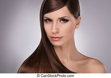 Hairstyle. Portrait of attractive young women with beautiful...